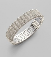 EXCLUSIVELY AT SAKS. A subtle ruffle design in glimmering crystal pavé.Crystal Rhodium plated Width, about ½ Diameter, about 2½ Hinged closure Imported