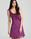 A sleeveless chemise with cascading ruffles along neckline and hem.