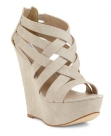 Exceptional beauty. Steve Madden Women's Xcess platform wedge sandals take caged vamps and wedge heels to new heights. And the results are amazing.